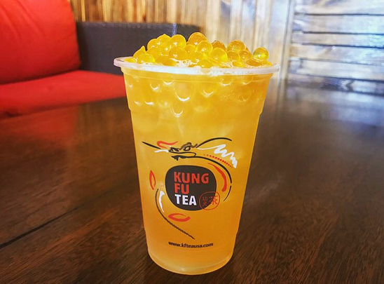 Mango popping boba in mango tea